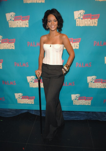 """NEW YORK - AUGUST 07:  Singer Rihanna during MTV's """"TRL"""" announcing the nominations for the 2007 MTV Video Music Awards at MTV Studios in Times Square on August 7, 2007 in New York City.  (Photo by Stephen Lovekin/WireImage)"""