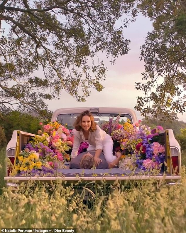A little fun in the back of a truck:She also said, 'What would you do for love?' Here she is seen over her man